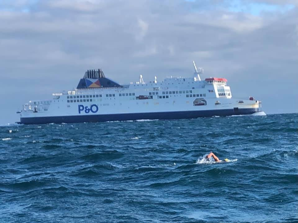 swimmer in front of P&O ferry
